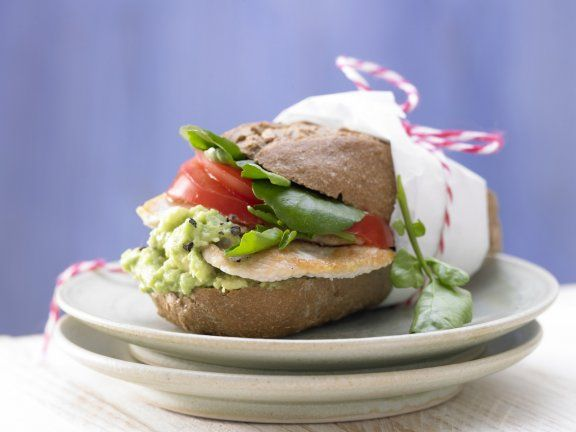 These turkey burgers are served on  whole-wheat buns and stacked with avocado, tomatoes, and watercress, making a refreshing and filling snack. | Eat Smarter