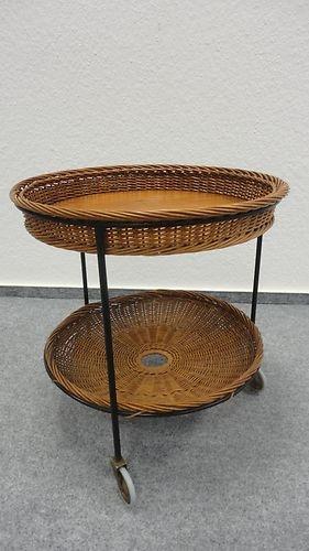 Lovely vintage wicker basket table on wheels.