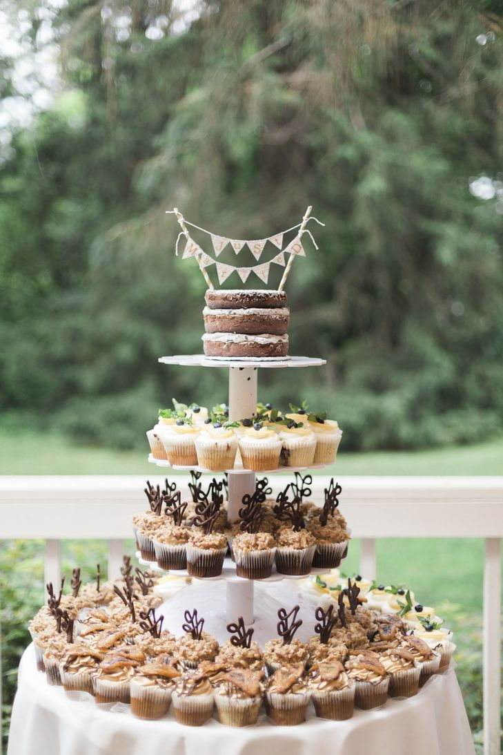 Tiered Cupcake Display With Naked Cake Top Tier Wedding Dessert Stand | Photo: Harlow Bliss Photography |