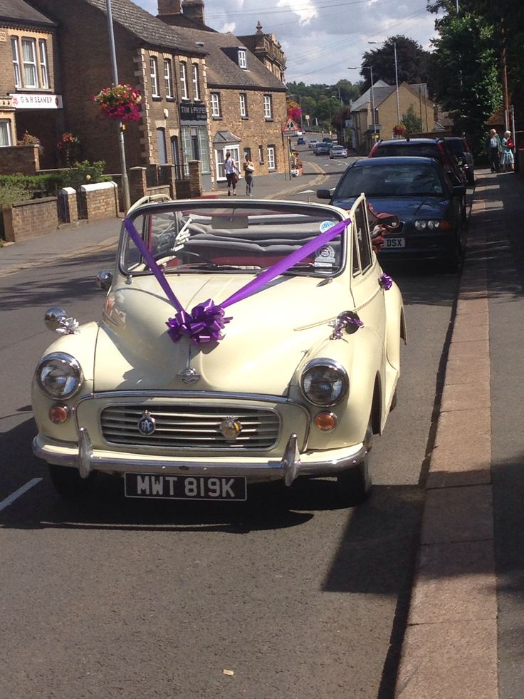 This is Maggie our cute Morris minor convertible she is for wedding hire at www.pearlweddingcar.co.uk