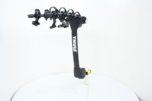 """This hitch-mounted 4-bike carrier has dual arced arms with cushioned anti-sway cradles for optimum bike spacing and for mounting bikes at different heights. The mast tilts for cargo area access. Built-in cable lock lets you secure bikes to the rack. Call 800-298-8924 to order Thule hitch bike racks part number TH9029XT or order online at etrailer.com. Free expert support on all Thule products. Guaranteed Lowest Price and Fastest Shipping for Thule Vertex 4 Bike Rack - 1-1/4"""" and..."""