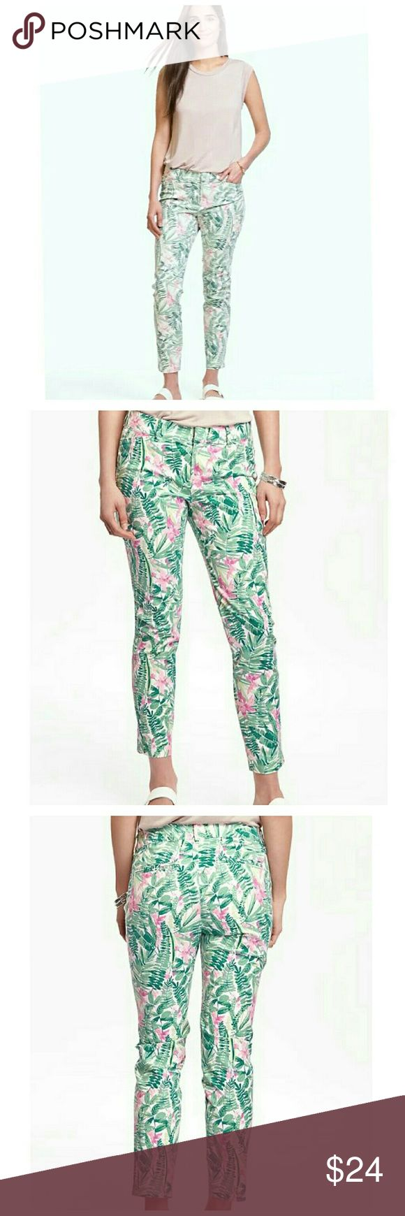 Old Navy Tropical Pixie Chino Pants Pants feature:  Tropical print  Double hook-and-bar closure, with interior button closure Zip fly Slit pockets in front faux welt pockets in back Smooth, medium-weight twill with added stretch Sits just above the waist Snug fit through hip and thigh Skinny leg hits at ankle 97% cotton, 3% spandex Machine wash Old Navy Pants