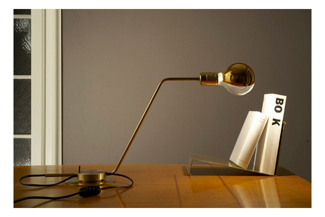 table lamp by restartmilano: Table lamp in bent brass tube with milling, 100-Watt lamp and light bulb, black wire, in-line rocker switch by Achille Castiglioni.