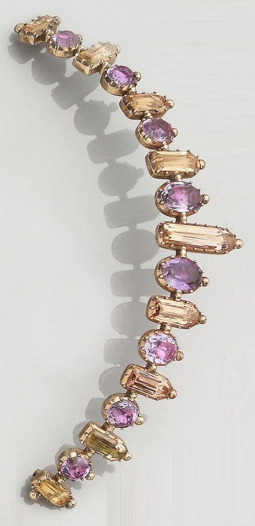 An antique amethyst and topaz tiara, circa 1830. Composed of graduated row of alternate oval-cut amethysts and long rectangular-cut topaz, to closed back settings. #antique #tiara