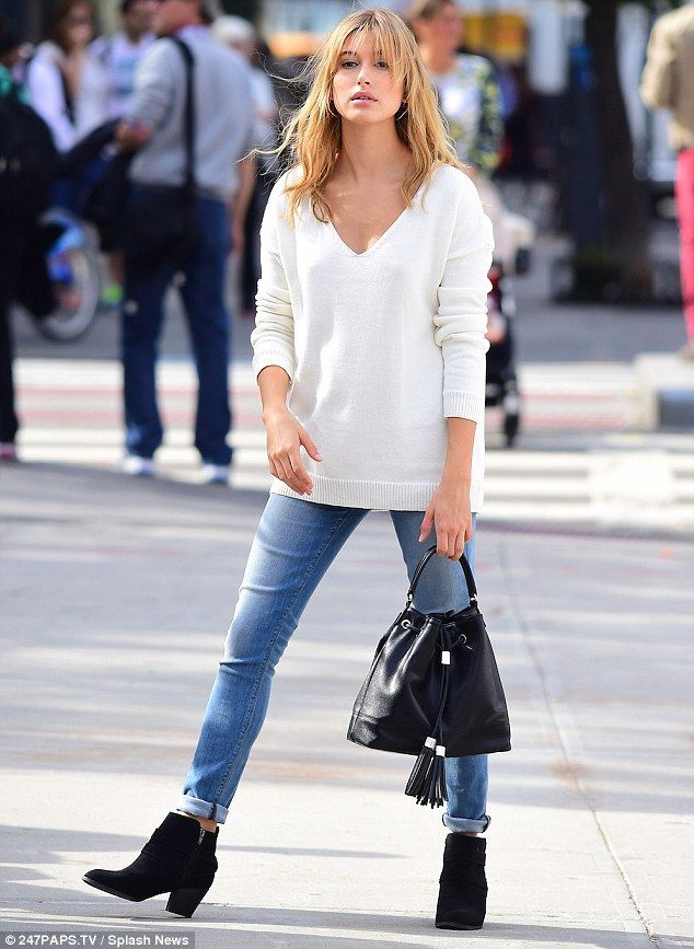 Casual but cool: Hailey also wore a pair of black ankle boots and carried a matching bucke...
