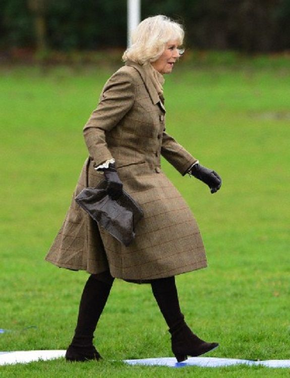 """Camilla, Duchess of Cornwall arrive by helicopter in Purleigh, Essex, UK where they visited """"The Bell"""" pub. on 29.01.14"""