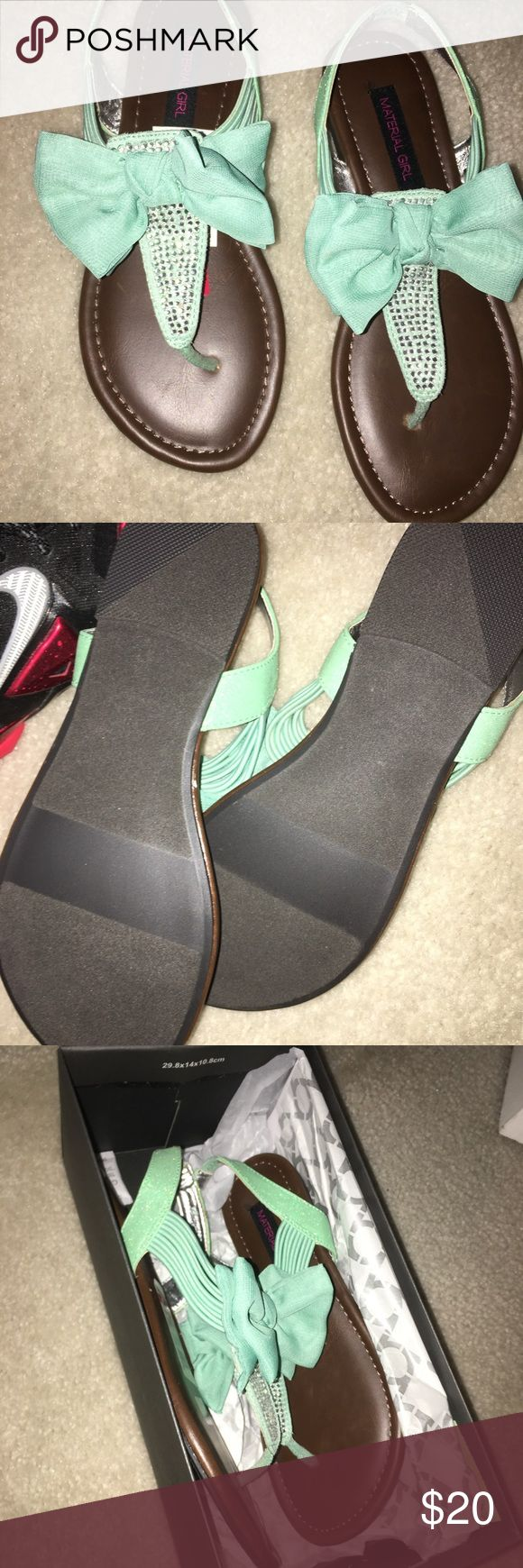 Brand new sandals with bow Brand new teal sandals with bow. Comes with box. Perfect to give as a gift Shoes Sandals