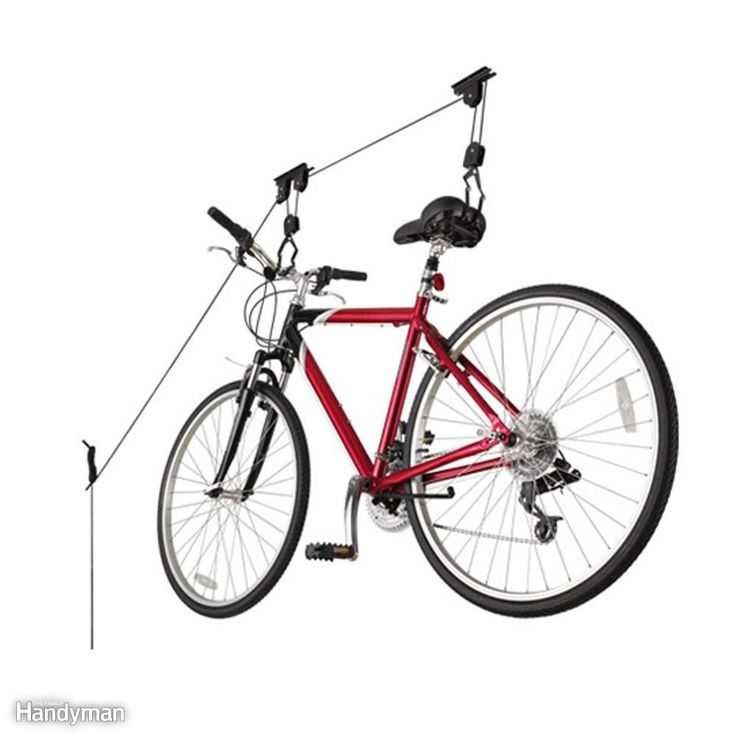 If you own a heavy bike, or lack the strength to lift it over your head, try a ceiling mounted pulley system and let physics ease the effort. This bike lift by Racor is easy to install and use.