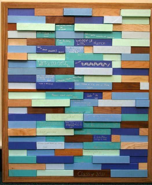 """3rd grade, """"Water"""" – this piece evokes myriad feelings from the warmth of the wood, to the colors of water, to the thoughtful """"aquacentric""""words from the children."""