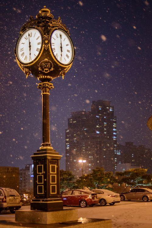 Snow in clock, Seoul, South Korea