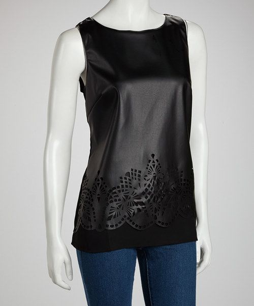 Crafted with a shiny luster to create an on-trend leather-like appearance, this tank showcases intricately detailed cutouts at the hem, while a zippered back adds edge.Measurements (size M): 27'' long from high point of shoulder to hem100% polyesterHand wash; hang dryImported