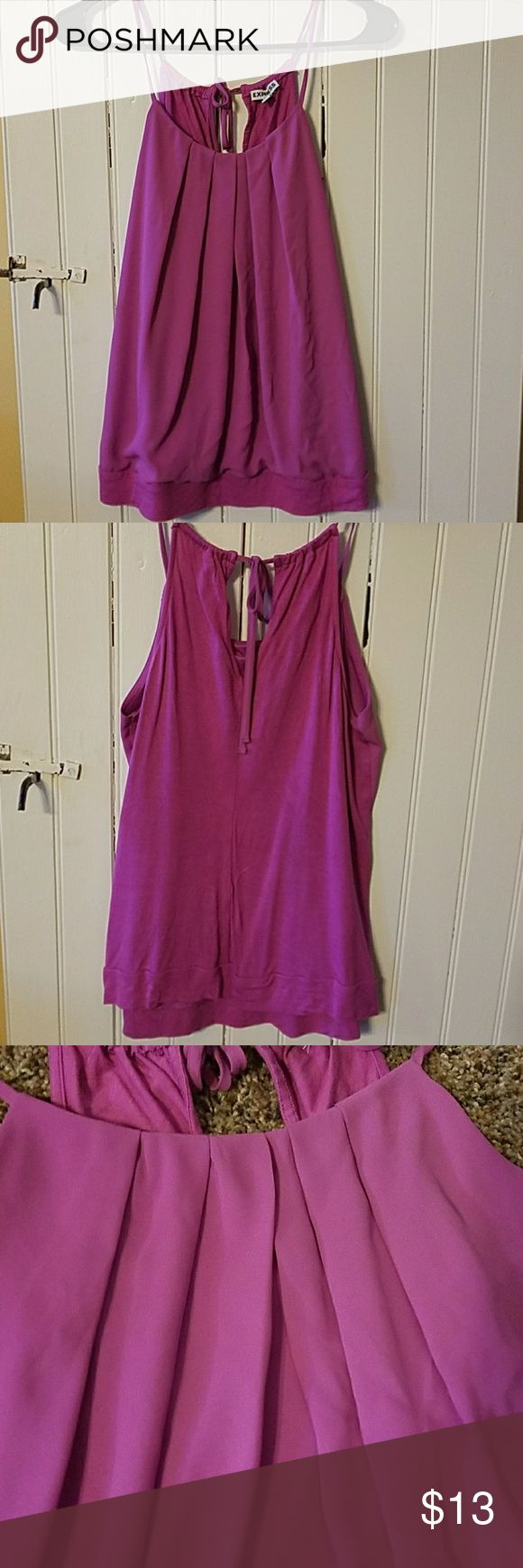 Express Pleated Banded strappy tank A pretty purple-ish-pink tank- perfect for summer with white skinny jeans ! Looks great with shorts and dark jeans too. The front is 100% polyester and the back is 100 % rayon. Very gently used! Express Tops Tank Tops