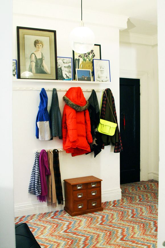 Entryway...shelf with hooks and eye level, additional hooks at a lower level.  Little Green Notebook