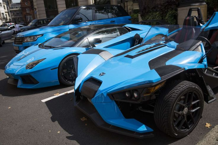 Slide 47 of 49: Supercars parked outside the Dorchester Hotel, London, Britain - 24 Aug 2016. Matching blue supercars outside the Dorchester Hotel