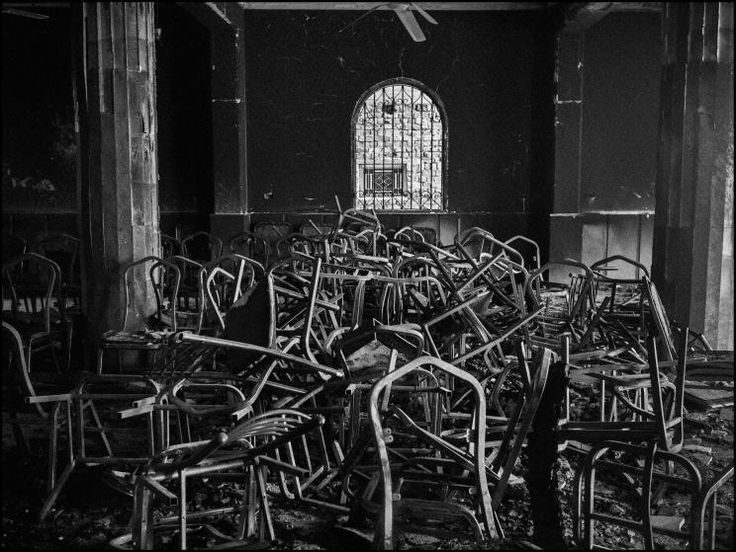 Burned chairs inside a church damaged during an Islamist mob attack. Al Nazla, Egypt, 2013.