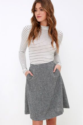 If your wardrobe is feeling worn out by Wednesday, give it a pick-me-up with the Mid-Week Motivation Grey Skirt! This closet essential begins with a high-waisted, tailored fit and convenient side pockets. Textured woven fabric shapes a midi, A-line silhouette for a chic and sophisticated look! Hidden back zipper.