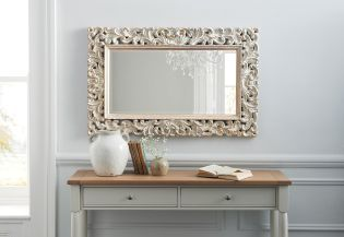 TIP: Putting up a mirror opposite your window will immediately brighten up your room, making it appear larger.