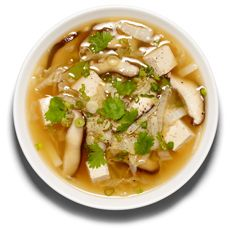 Hot and Sour soup with cabbage: Bring 8 cups chicken stock to boil with 2 tablespoons each minced garlic and ginger. Add 8 ounces sliced shiitakes and shredded Napa cabbage (5 cups); cook until softened, 5 minutes. Add 3 tablespoons soy sauce, 1/4 cup rice vinegar, 1 cup tofu cubes and black pepper. Cook 3 or 4 minutes. Garnish: Cilantro, scallions.