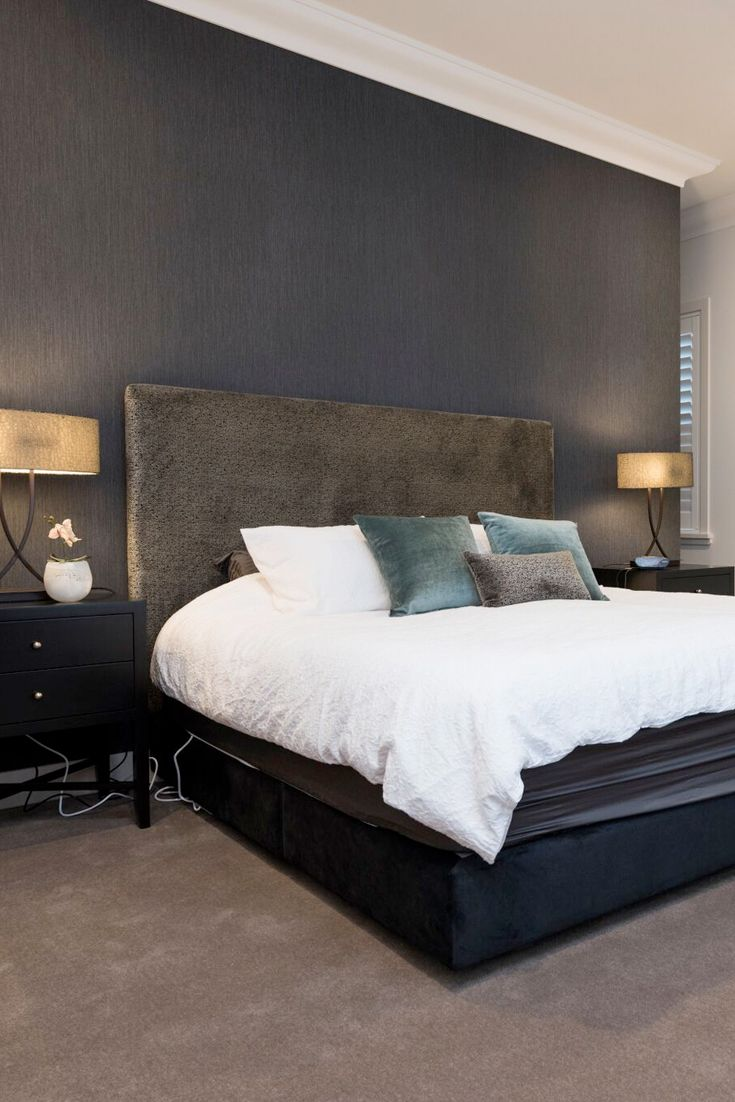 Master bedroom design with a charcoal, silver and blue colour palette.  Featuring upholstered bedhead and Bloomingdale table lamps.
