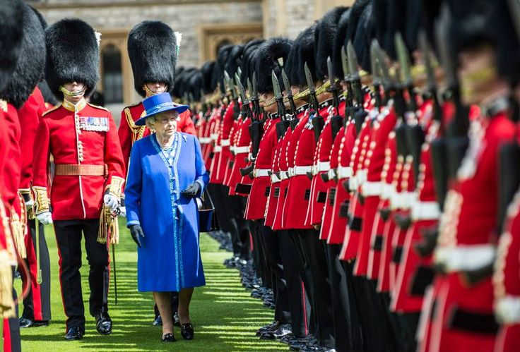 The Queen, Colonel-in-Chief to the 1st Battalion Welsh Guards inspects her troops at Windsor Castle