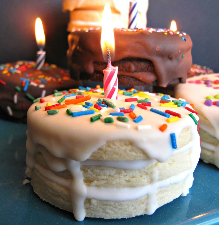 Birthday Cake Surprise Cookies- 3 layers of sugar cookie iced like a little cake. Bite to find the hidden m&m surprise inside!  | The Monday Box