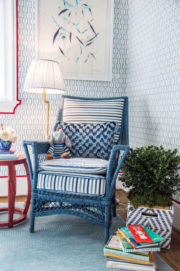 Blue and red kids room with striped reading chair and red ribbon trim around window on Thou Swell @thouswellblog