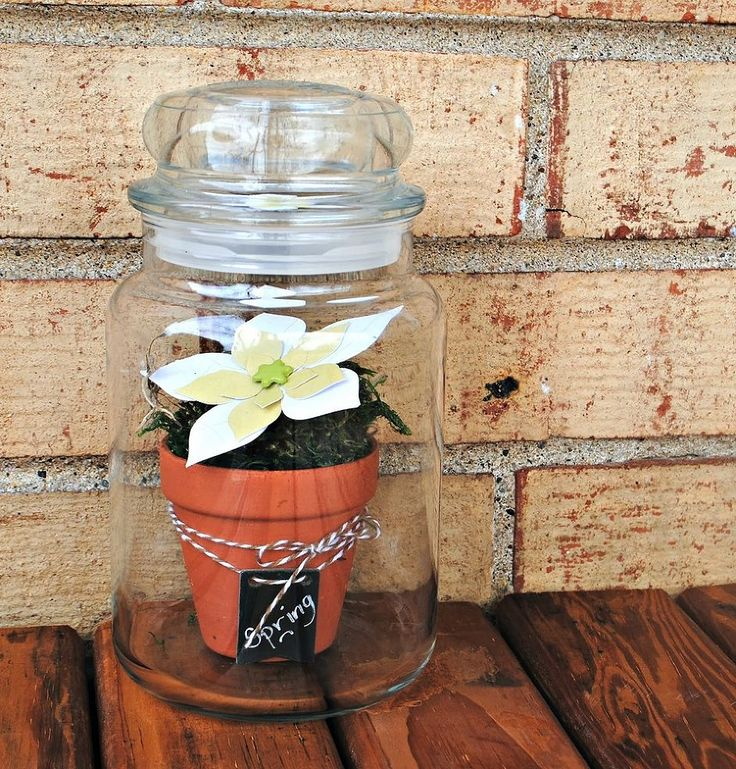 An awesome new use for your empty Yankee Candle jars! Make a faux terrarium for fresh and beautiful spring decor.