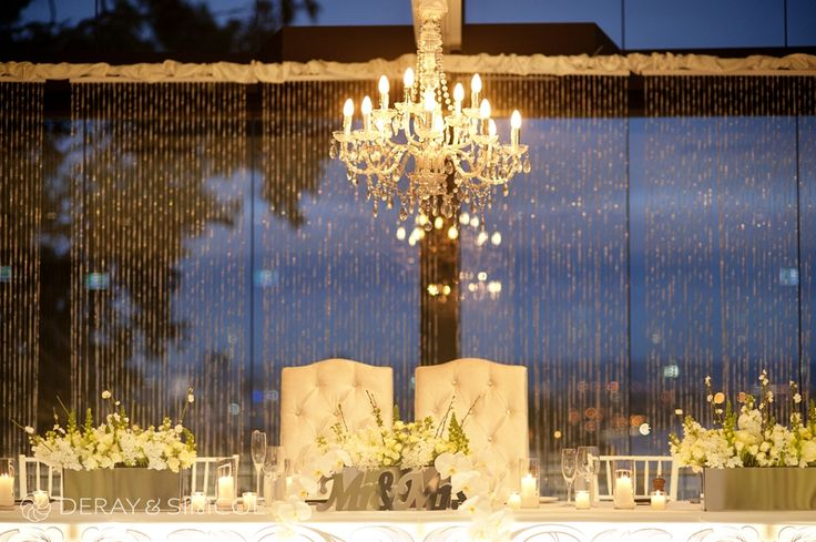 Crystals, elegant chandeliers, candles and flowers. Romantic wedding reception styling, ideas and inspiration. Reception Venue: State Reception Centre Perth  Photography by DeRay & Simcoe