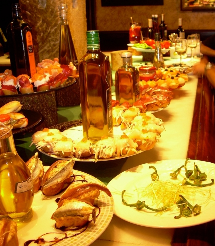 Eat Pintxos (Tapas) San Sebastian. Photo: http://www.flickr.com/photos/roryfinneren/