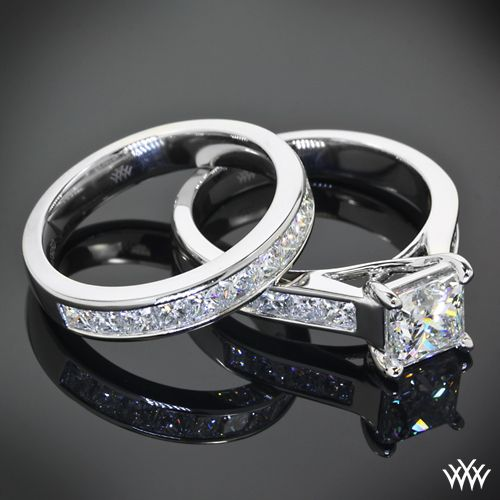 Quite an amazing duo, this Custom Channel Set Diamond Wedding Set is cast in platinum. The 4 prong Engagement Ring holds Princess Cut Diamond Melee and has a trellis style design. The Custom Wedding Ring Princess Cut Diamond Melee.