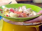 Spicy fish stew, inspired by Rachael Ray. Use all tilapia (no scallops), Old Bay seasoning (instead of thyme), add some sweet red peppers to the onions (no fennel or leeks), & a few dashes of hot sauce. Fan-tastic!