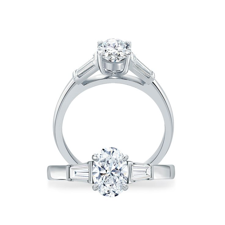 #Oval Cut #Solitaire with Tapered #Baguettes   Elegant oval cut #diamond ring in a four prong setting enhanced by two tapered baguette diamonds   #paulbram