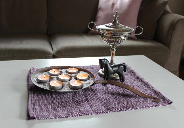 Upcycle an old copperpan into a candle holder.