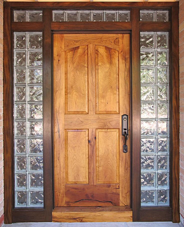 Wood door with glass block windows.   I have always loved glass brink windows - Although I'd probably not have a wood door.