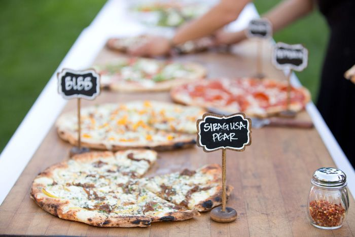 Consider foods that don't require sitting in a chafing dish for hours like a cold seafood bar, or our personal favorite, a pizza buffet! Sourec: stylemepretty.com #reception #weddingfood