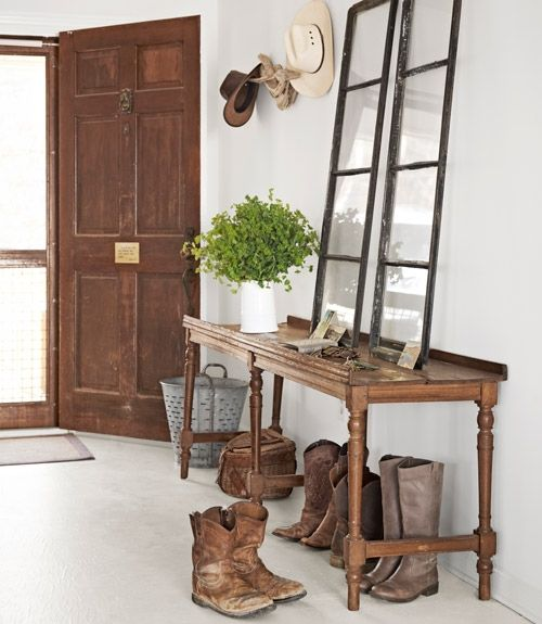 Simple and timeless look, antique finds in the small foyer of this beach home