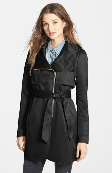 Free shipping and returns on French Connection Tulip Hem Hooded Raincoat (Online Only) at Nordstrom.com. A shimmery rain trench takes modern shape with a wide, convertible collar that cuts back to a drawcord hood, oversized gunflaps and asymmetrical-zip front with a tulip-cut hem.