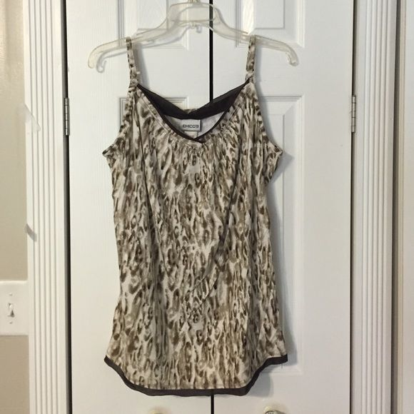 Chicos Leopard Print Tank Top Chicos Leopard Print Tank Top - adjustable straps, neck (front and back) and bottom are trimmed in brown (as seen in photo 2) - see photo 3 for Chicos Size Chart Chico's Tops Camisoles