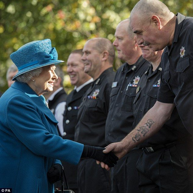 Queen Elizabeth II meets members of the local fire service during a visit to Ballater...