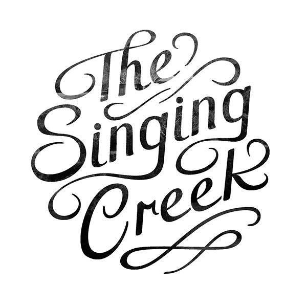 The Singing Creek Honey Logo