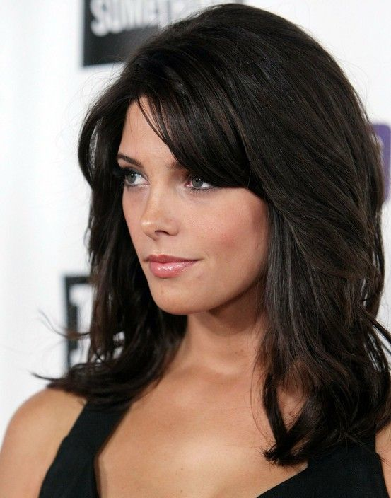 medium length haircut with lots of layers// Maybe no bangs, leave them the length they are now so they can grow out?