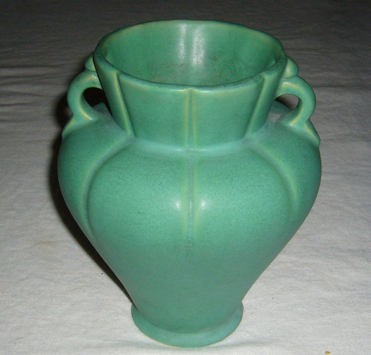 Nice estate collection art deco vase from the Arts & Crafts era by Weller. Weller Matte Green was created in response to the success of Grueby's matte green. Over 30 potteries produced matte green pottery during the Arts and Crafts Movement of the early 1900s. The matte green pottery produced by Weller ranks among the more desirable by arts and crafts pottery collectors.  In general, the vase forms used by Weller for its matte green pottery were more pleasing than that produced by…
