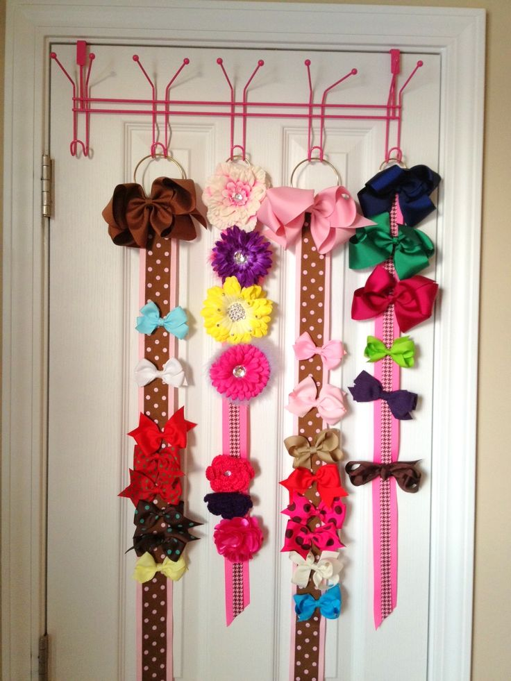 LOVE how Rose from Rubbermaid organizes and displays her daughter's bows. You could also just put hooks on the back of the door - and then add keyring looks at the top of ribbons and then hang it on the hooks..