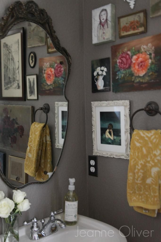 I love the idea of several various framed/unframed images on the powder room wall.