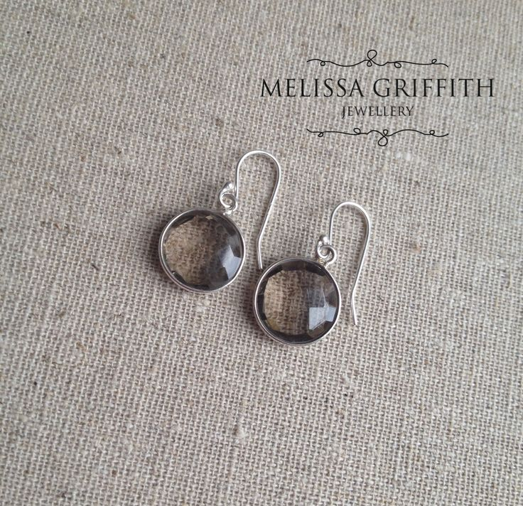 Smokey Quartz Bezel Earrings (MGE78) $34.00 Lovely faceted smokey quartz gemstones have been set and hung in sterling silver to create these feminine and dainty earrings. Smokey quartz stones are 12mm wide and earrings measure 1 inch from top of earring hook.