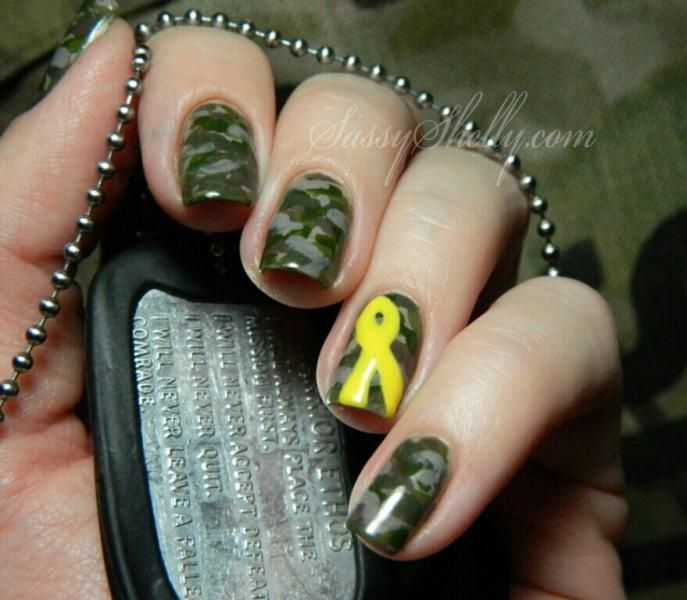 Sweet camouflage nails with a yellow ribbon to support our troops!