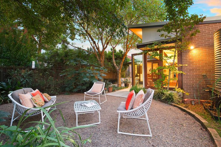 Beautiful family home, private level garden, outdoor setting, throw cushions, leafy, green, Pilcher Residential
