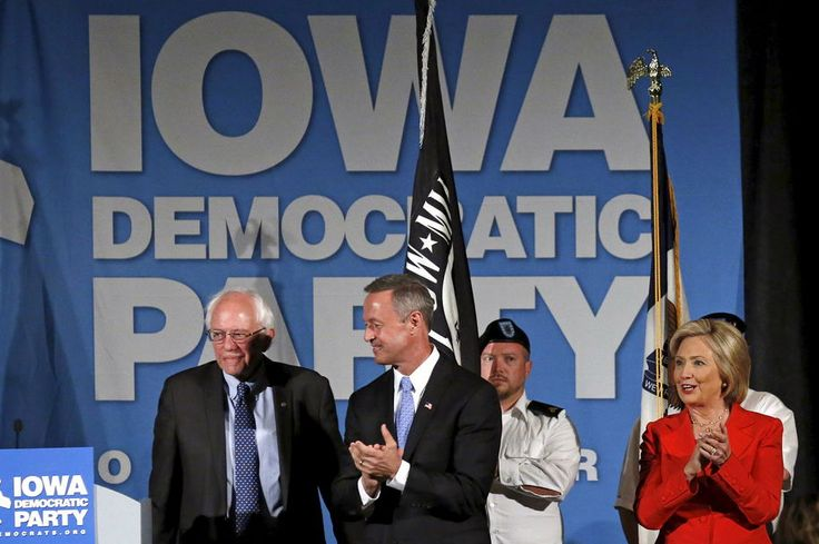 U.S. Democratic presidential candidates  Hillary Clinton (R) is joined on stage by Martin O'Malley (C) and Bernie Sanders for the Iowa Democratic Party's Hall of Fame dinner in Cedar Rapids, Iowa, United States, July 17, 2015. REUTERS/Jim Young   - RTX1KR