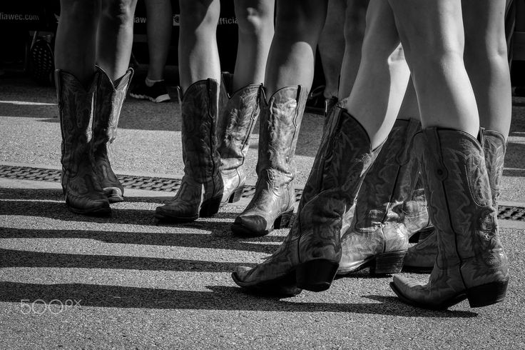 Nothing but boots. - Boots of the grid girls.
