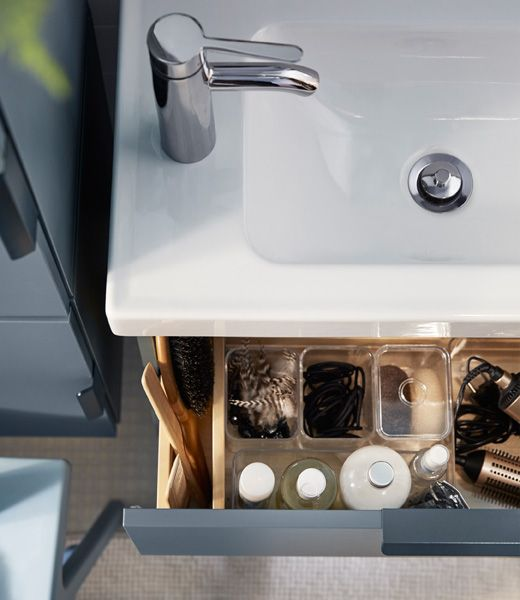Looking for big storage in a small bathroom? One tip is to use drawer organizers to keep small things in check.
